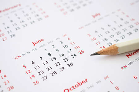 white pencil on calendar background business planning appointment meeting concept Banco de Imagens