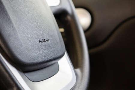 Safety airbag sign on car steering wheel Banco de Imagens