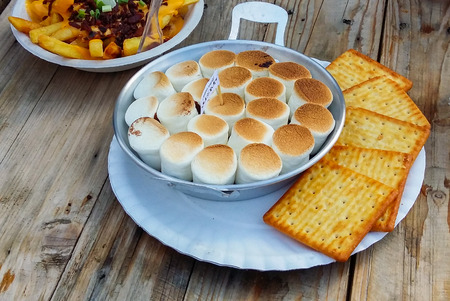 marshmellow: Smores with marshmellow,chocolate and cracker on wooden table Stock Photo
