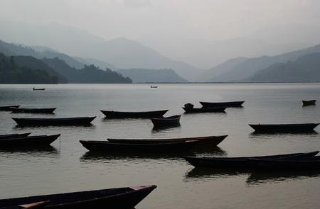 Monotonous picture of many boats on Phewa lake in Pokhara, Nepal. photo