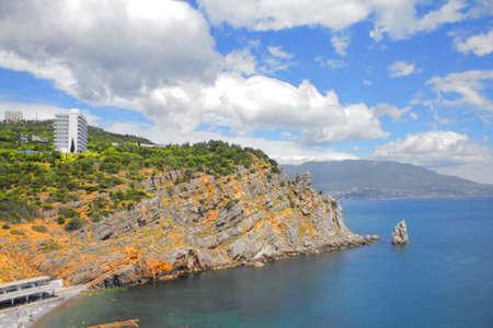 Beautiful rocky coastline in the Black Sea near the Castle Swallows Nest, city of Yalta Crimea, Crimean Peninsula