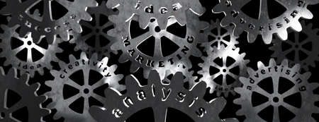 Business concept MARKETING: words metal letters in gears. 3d rendering