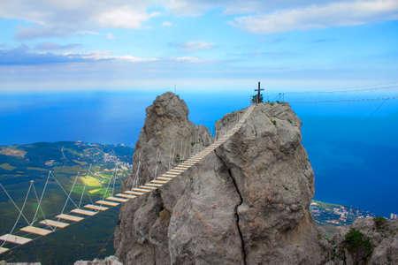 Rope bridge over the precipice on Mount Ai-Petri rock Banco de Imagens