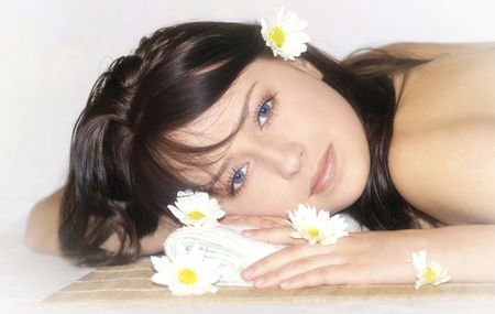Brunette relaxing at spa. photo