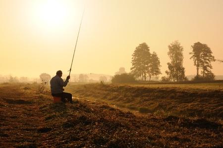 fishingpole: Hobby fishing in autumn morning.