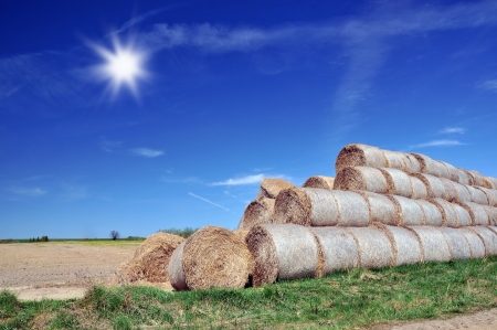 Big haystack over blue sky background photo
