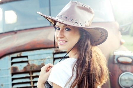 Beautiful caucasian brunette working as cowboy  Stock Photo