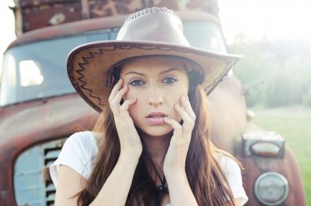 Beautiful caucasian brunette working as cowboy  photo