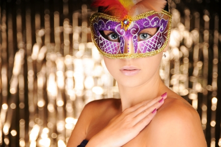 Beautiful young woman in carnival mask Stock Photo - 14962363