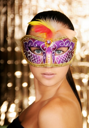 Beautiful young woman in carnival mask photo