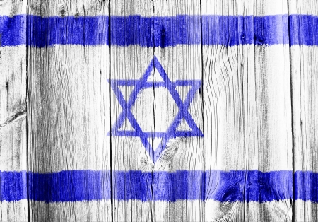 The Israeli flag painted on wooden pad Stock Photo - 15720909