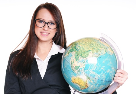 Pretty young teacher with globe over white background Stock Photo - 15719870