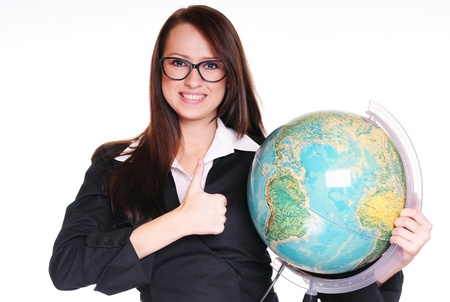 Pretty young teacher with globe over white background Stock Photo - 15719896