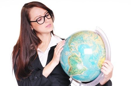 Pretty young teacher with globe over white background Stock Photo - 15719884