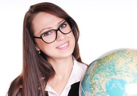 Pretty young teacher with globe over white background Stock Photo - 15719883
