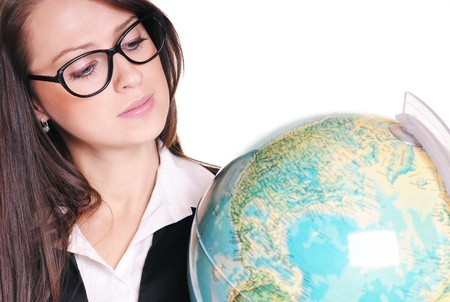 Pretty young teacher with globe over white background Stock Photo - 15719866