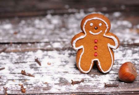 gingerbread man: homemade christmas cookies on wooden background Stock Photo