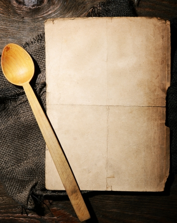 rustic food: Old dirty paper and wooden spoon - menu concept