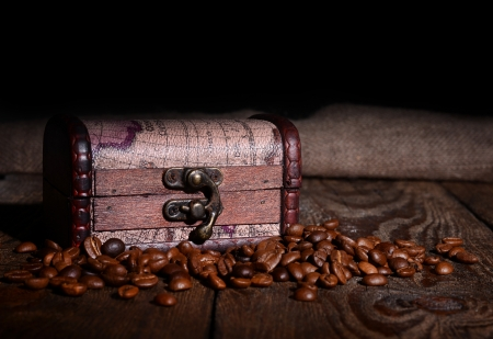 Old wooden chest and coffee beans - food concept photo