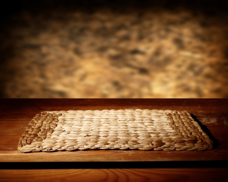 Empty wooden table and defocused brown wall Stock Photo - 22098313