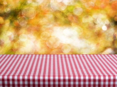Empty checkered table and autumn defocused background. Great for product display montages.