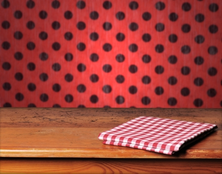 Empty wooden table and red wall in background  Great for product display montages  photo
