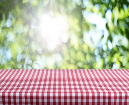 Empty checkered table and summer background. Great for product display montages.