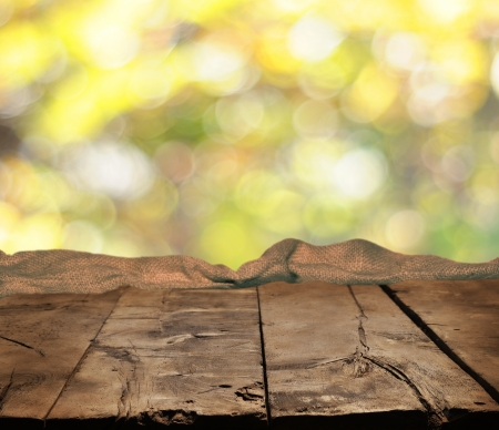 Empty table and autumn background photo