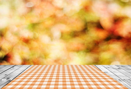 Empty wooden table and autumn background photo