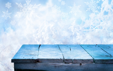 indoors: Empty wooden table for product display montages - winter theme