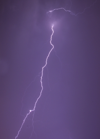 dazzle: Lightning bolt at night Stock Photo