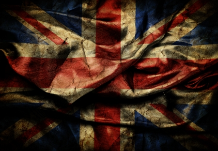 Dirty flag of Great Britain on silk background photo