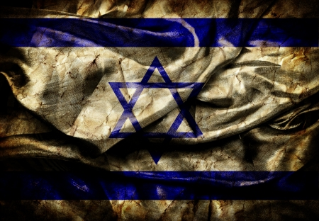 Dirty flag of Israel on silk background photo