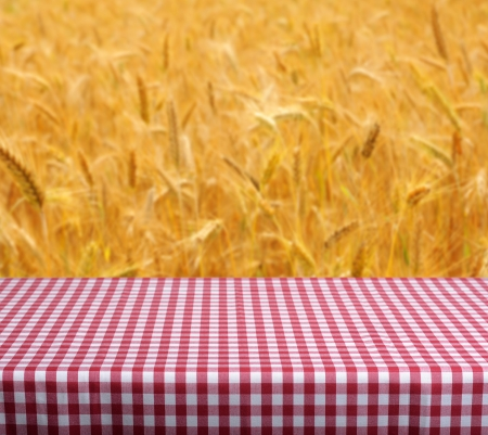 Empty table and defocused wheat field in background. Great for product display montages. photo