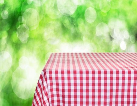 on the tablecloth: Empty checkered tabletop for product display montages