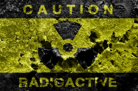 Radioactive sign on old rusty metal barrel photo