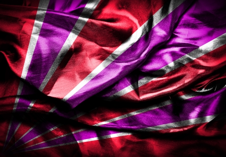 Red and violet stripes on silk background photo