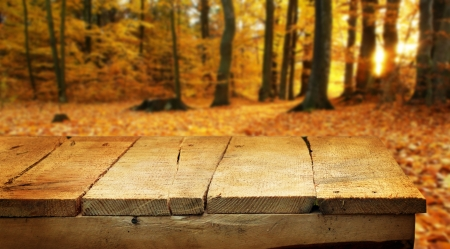 Empty wooden table for product display montages - autumn theme photo