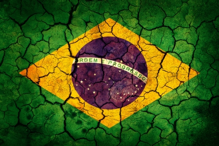 brazil symbol: Brazil flag painted on cracked earth background
