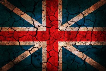 England flag painted on cracked earth background photo