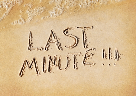 finite: Last minute word written on beach sand