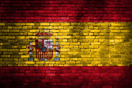 Spain flag on old grunge brick wall photo