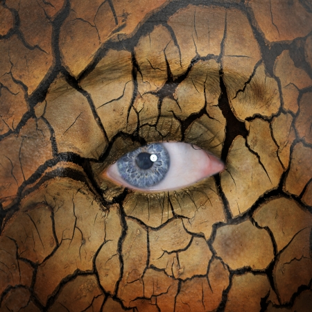 Woman face with cracked brown earth pattern photo