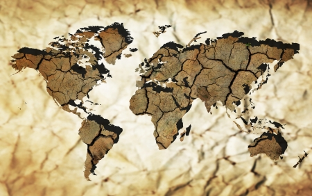 Map of the world with continents from dry deserted soil over old paper background photo