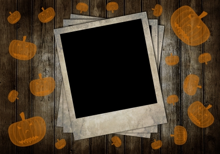 Retro photo frames on brown wooden background with pumpkins photo
