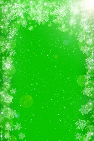 Green christmas background with bokeh circles and white snowflakes photo