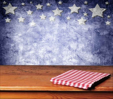 Empty wooden deck table with tablecloth for USA holidays background montages photo