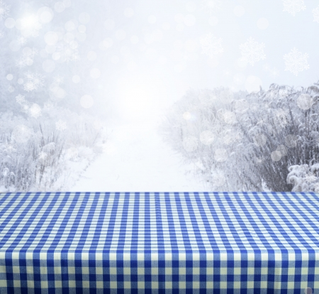 Empty blue table with winter background. Ready for product display montage. photo