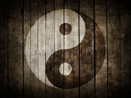 The Ying Yang sign painted on wooden wall photo