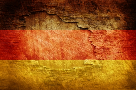 Germany flag painted on old wooden background photo